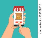 order pizza online. hand... | Shutterstock .eps vector #559530718