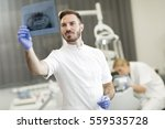 dentist analyzing x ray of teeth | Shutterstock . vector #559535728