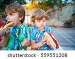 Two Little Kid Boys Eating Hot...
