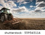 Tractor Preparing Land For...