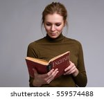 young pretty girl reading a... | Shutterstock . vector #559574488