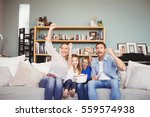 happy family with arms raised... | Shutterstock . vector #559574938