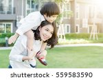 mother and her daughters... | Shutterstock . vector #559583590
