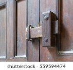 closeup of a wooden aged latch... | Shutterstock . vector #559594474