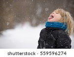 cute blond kid boy catching... | Shutterstock . vector #559596274