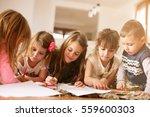 large group of children write... | Shutterstock . vector #559600303