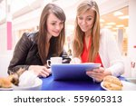women using digital tablet... | Shutterstock . vector #559605313