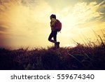 successful hiker walking on... | Shutterstock . vector #559674340