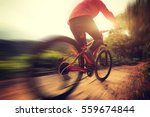 younng woman riding mountain... | Shutterstock . vector #559674844