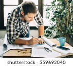 young man working on... | Shutterstock . vector #559692040
