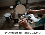 elderly woman washing dishes at ... | Shutterstock . vector #559723240