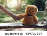 a girl hold hand teddy bear her ... | Shutterstock . vector #559727839