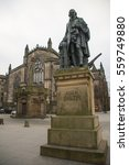 Small photo of Statue of Adam Smith, the Father of Economics, with St Giles' Cathedral, Edinburgh, Scotland