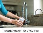 pretty blonde woman filling a... | Shutterstock . vector #559757440