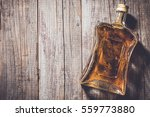 bottle of whiskey | Shutterstock . vector #559773880