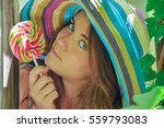funny girl wearing a colorful... | Shutterstock . vector #559793083