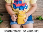 boy drinking juicy smoothie... | Shutterstock . vector #559806784