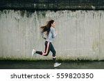 female urban athlete running... | Shutterstock . vector #559820350
