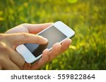 young man using a cell phone at ... | Shutterstock . vector #559822864