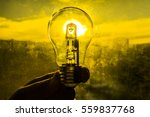 light bulb above sunset urban... | Shutterstock . vector #559837768
