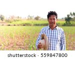 middle aged farmer and his farm | Shutterstock . vector #559847800