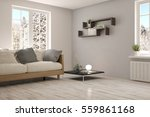 white room with sofa and winter