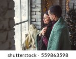 a man and a woman hugging near... | Shutterstock . vector #559863598