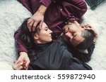 man and woman embracing in bed. ... | Shutterstock . vector #559872940