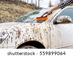 man washes away the dirt with a ... | Shutterstock . vector #559899064