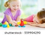 two cute little sisters having...   Shutterstock . vector #559904290