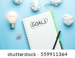 goals text on notebook with... | Shutterstock . vector #559911364