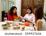 woman sitting with friends... | Shutterstock . vector #559927636