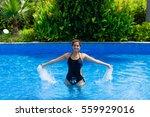 girl in pool | Shutterstock . vector #559929016