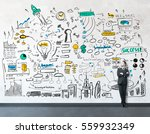 young businessman and drawing...   Shutterstock . vector #559932349