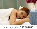 young woman in spa  flower in... | Shutterstock . vector #559948480