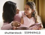 Mother Looks At Daughter...