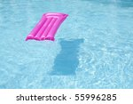 Bright Blue Pool with a Pink Raft Water on a Sunny Summer Day. - stock photo