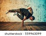 young man break dancing on wall ... | Shutterstock . vector #559963099