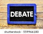 Small photo of Debate / Blackboard chalk inscription debate on wood.