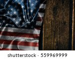 usa flag on a wood surface | Shutterstock . vector #559969999
