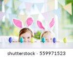 two cute little sisters wearing ... | Shutterstock . vector #559971523