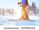 skiing downhill  skier in... | Shutterstock . vector #559980103