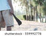 man holding rusty machete. | Shutterstock . vector #559992778