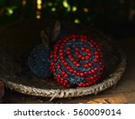 Small photo of Ball made of red seeds adenanthera pavonina