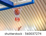 basketball going through the... | Shutterstock . vector #560037274