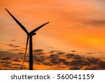 sunset showing wind turbine... | Shutterstock . vector #560041159