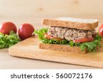 tuna sandwich on wood board | Shutterstock . vector #560072176
