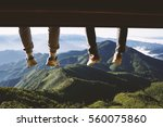 two men legs hanging from the... | Shutterstock . vector #560075860