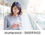 woman using cellphone   Shutterstock . vector #560093410
