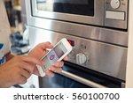 smart home  man controlling... | Shutterstock . vector #560100700